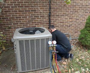 Technician providing AC system repair in Newark, DE